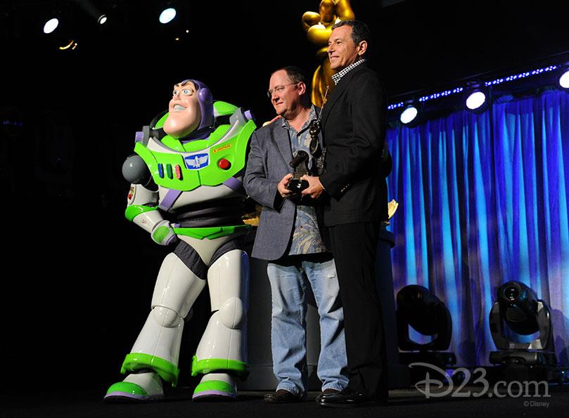 John Lasseter and Buzz Lightyear receiving the Disney Legend Award on Steve Jobs behalf