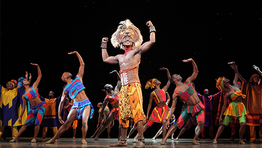 photo of cast of The Lion King on stage