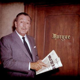 Walt Disney standing in front the city morgue