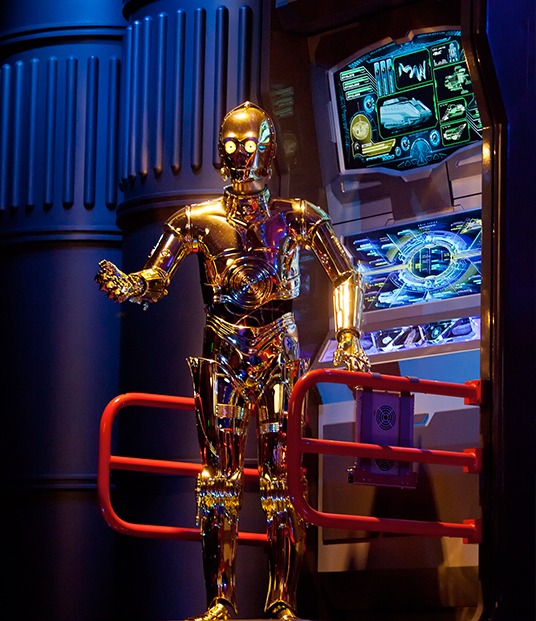 photo of Audio-Animatron version of C-3PO android speaking from electronic console