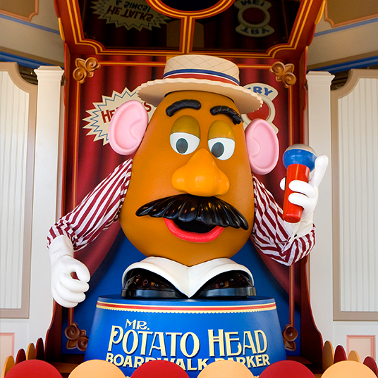 photo of Mr. Potato Head at colorful podium wearing carnival outfit