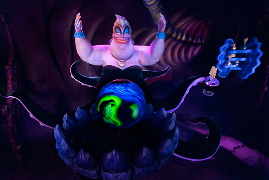 photo of Audio-Animatronic Ursula smiling raising her purple-colored arms