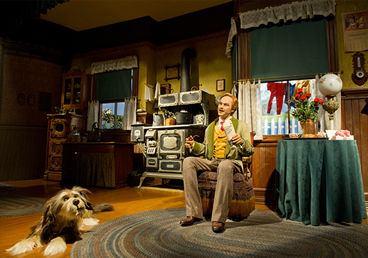 photo of model home with Audio-Animatronics-driven man and dog occupying kitchen