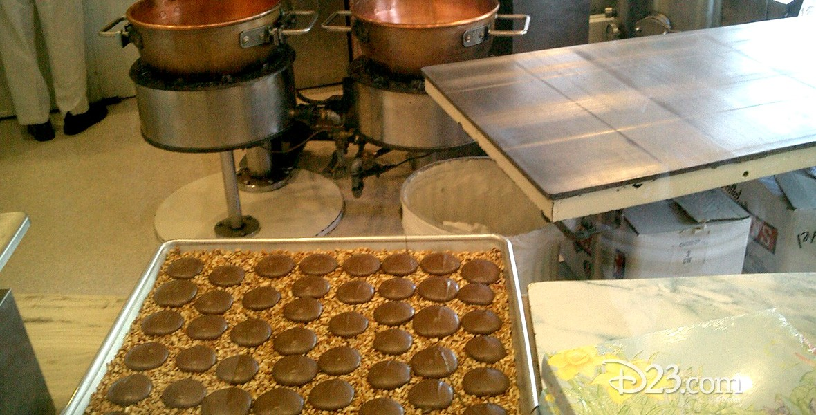 photo of rows of chocolate confections on a cookie sheet in the kitchen of Candy Palace Shop on Main Street at Disneyland