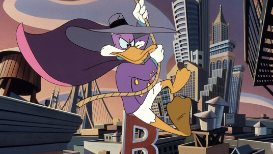 still from DarkWing Duck showing lead character sweeping over the metropolis swinging from a rope