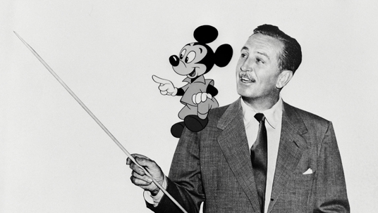 Desktop wallpaper of Walt Disney with Mickey Mouse on his shoulder