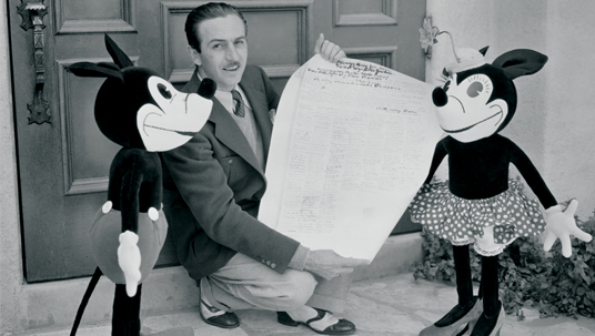 Desktop Wallpaper of Walt Disney with large Mickey and Minnie Mouse dolls