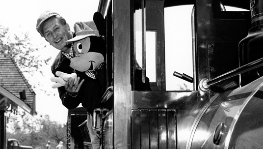 Desktop wallpaper of Walt Disney riding a train with Mickey Mouse