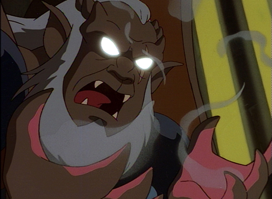 still from animated Gargoyles showing evil looking creature with glowing eyes