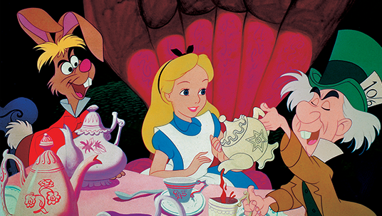 still from animated Alice in Wonderland featuring March Hare, Mad Hatter pouring tea for Alice