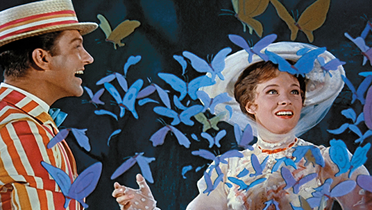 still from movie Mary Poppins featuring Dick Van Dyke and Julie Andrews singing amidst fluttering butterflies