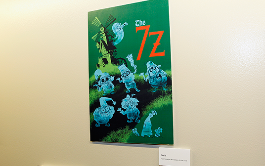 photo of a mounted illustration of seven ghostly Dwarf-like characters called The 7 Z