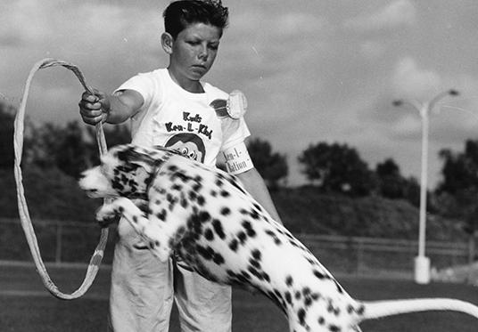 Boy and dalmatian at Disneyland First Annual Kids' Amateur Dog Show