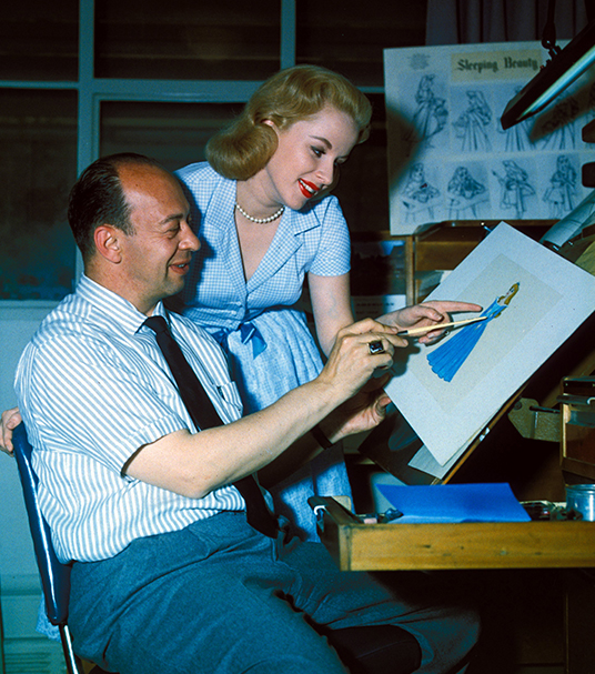 photo of Mary Costa with Sleeping Beauty artist looking at illustrations for the Princess