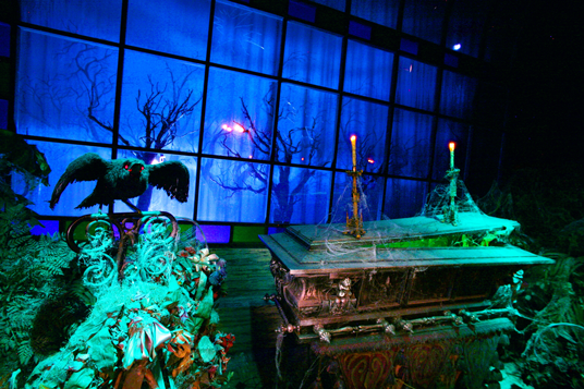 photo of crypt and  Audio-Animatronics® raven in Haunted Mansion attraction