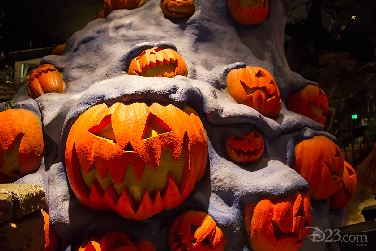 photo of grinning and grimacing Jack-O-Lanterns erupting out of a mound of purple frozen lava