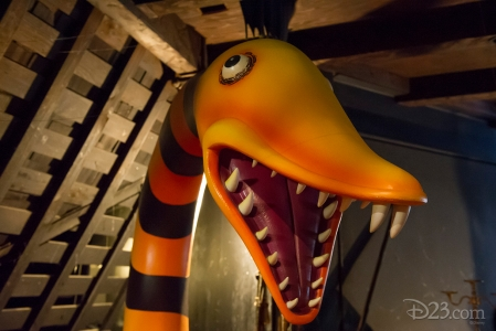 photo of large orange and black striped serpent rearing up with open mouth showing lots of teeth