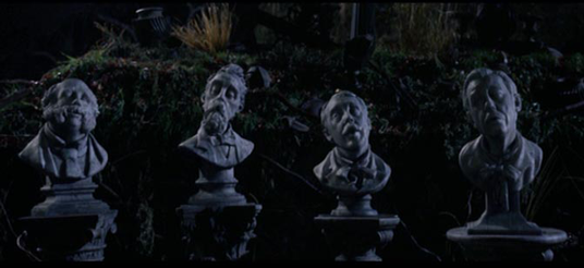 photo of four singing busts designed by Rick Baker originally for the Haunted Mansion film