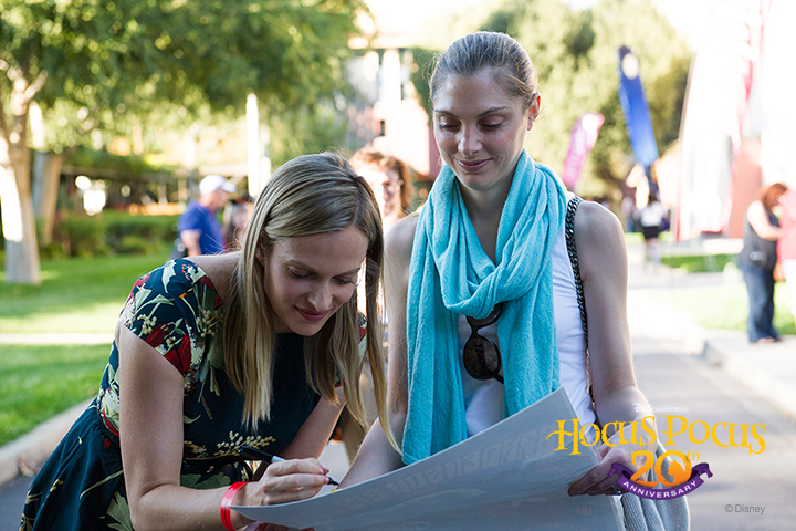 Actress Vinessa Shaw (Allison) signs an autograph for a Disney fan.