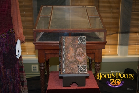 Inside the Walt Disney Archives exhibit, D23 Members and the <em>Hocus Pocus</em> cast and crew come face to face with props and costumes from the film, including Winifred Sanderson's famous spell book.