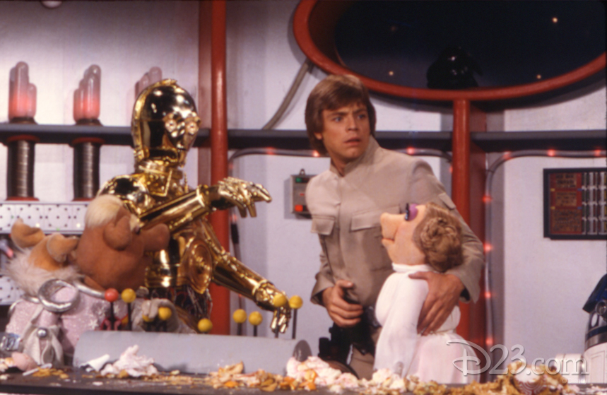Miss Piggy and C-3P0 on the set of The Empire Strikes Back with Mark Hamill.