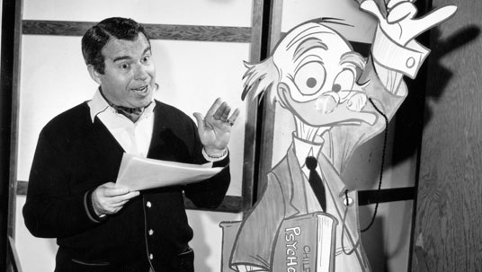 photo of Paul Frees, voice of the Haunted Mansion's Ghost Host, with a drawing of Ludwig Von Drake, for whom he also provided voice