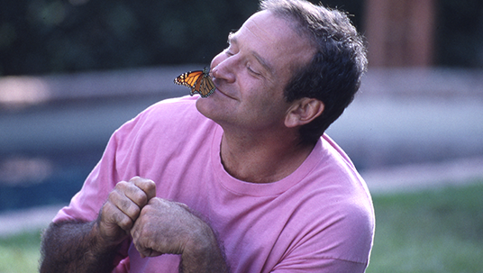 Photo of Robin Williams and a Butterfly