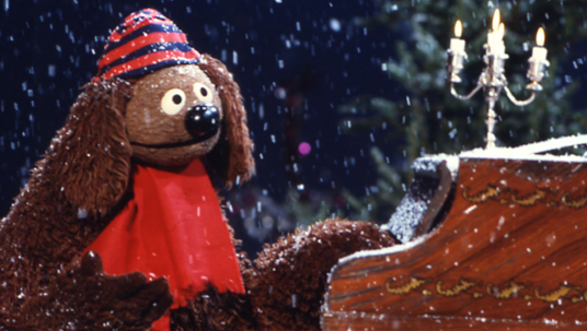 Rowlf the Muppet Dog tickling the keys of an upright piano