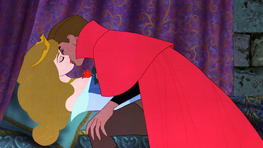 still frame of Sleeping Beauty showing the prince kissing the princess