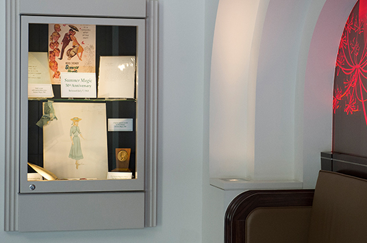 As a tribute to the film, the Walt Disney Archives put together a small display of props and costume concept art from the film in the theater's lobby.