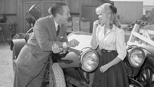 "Walt and Hayley chat in front of another Summer Magic ""star,"" the Stutz Bearcat motorcar."