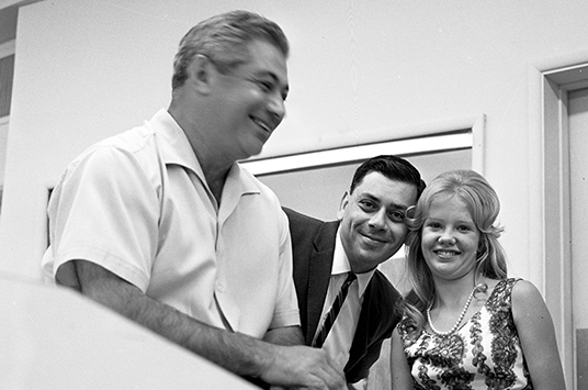 From left: Tutti Camarata, Robert Sherman, and Hayley Mills at a recording studio.