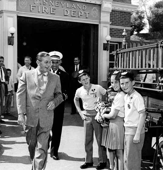 Walt Disney with some well-dressed Mouseketeers
