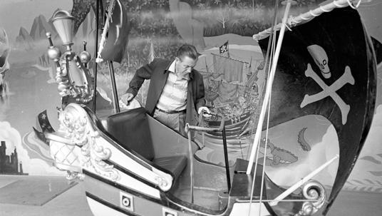 Walt Disney at the Peter Pan's Flight attraction at Disneyland.