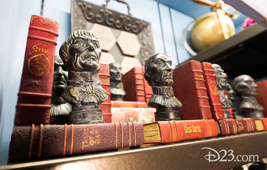photo of hardcover books with names such as Tales of a Rat and Ghost Stories with brass busts of stern looking gentlemen