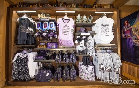 photo of merchandise in store including Madame Leota themed tee shirts, jerseys, purses, shoes, handbags, and bric-a-brac