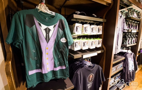 photo of merchandise displayed including Ghost Host green and black tee shirts and watches