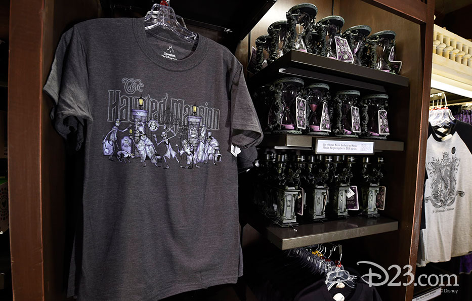 photo of merchandise displayed including Haunted Mansion black tee shirt and souvenirs