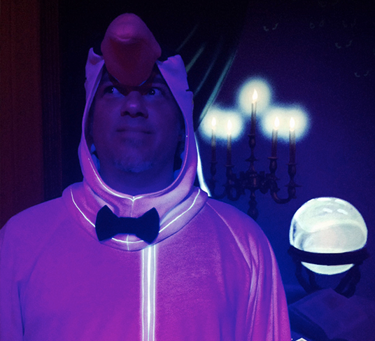 blacklight-illuminated photo of Brian Frey dressed up as a penguin based on those from Mary Poppins
