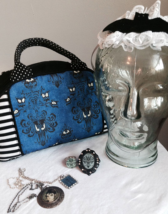 photo of eye wallpaper purse and various pendants inspired by Haunted Mansion