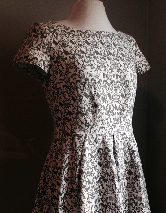 photo of dress created by Holly Frey with black and white patterns based on Haunted Mansion designs
