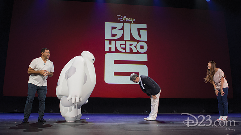 photo of Shinji Hashimoto, Larry Sparks, and Kaori Takasue on stage with Baymax from Disney Big Hero 6