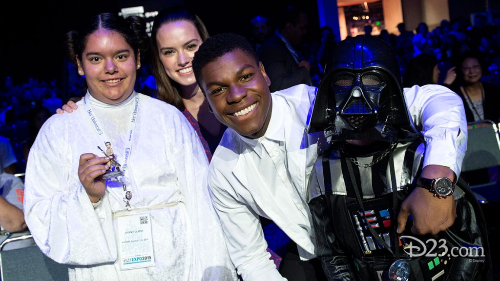 DAISY RIDLEY, JOHN BOYEGA with a Star Wars fan