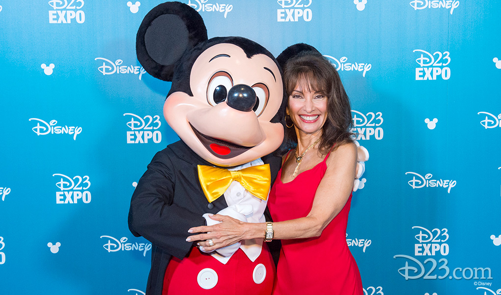 photo of Susan Lucci with Mickey Mouse after receiving Disney Legends Award