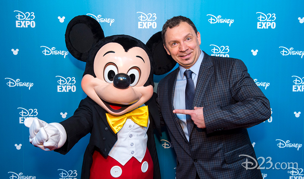 photo of Andreas Deja with Mickey Mouse after receiving Disney Legends Award