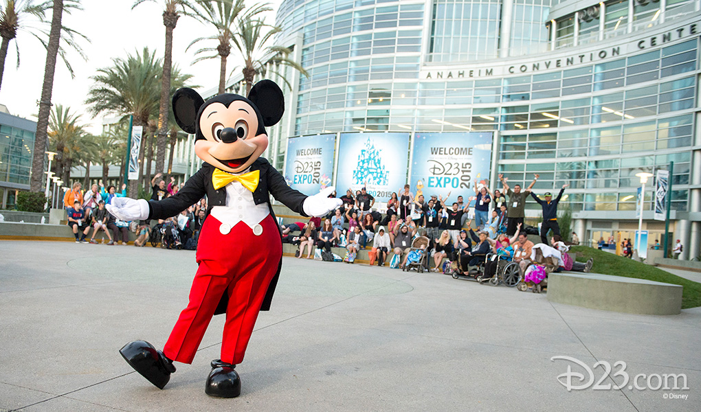 photo of life-size Mickey Mouse character Mickey Mouse entertaining fans outside Anaheim Convention Center