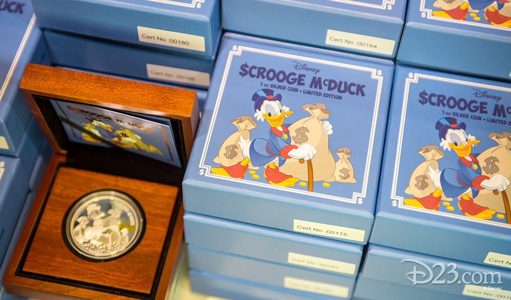 photo of stacks of Scrooge McDuck 1oz Limited Edition Silver Coins at D23 EXPO 2015