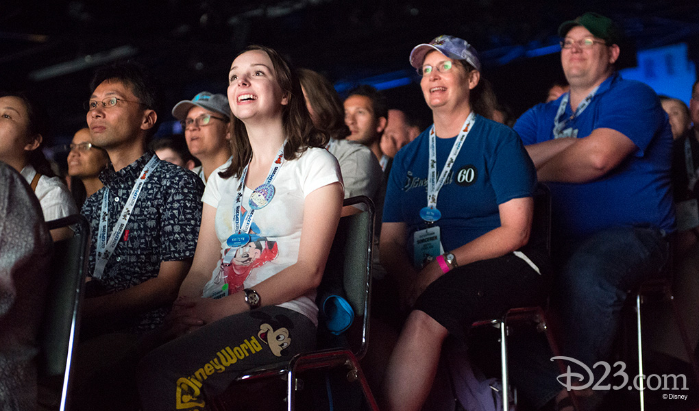 photo of seated audience raptly staring, smiling or grinning, watching the presentation at D23 EXPO 2015