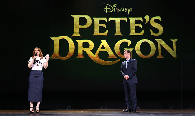 photo of Bryce Dallas Howard and Sean Bailey with banner for Disney Pete's Dragon