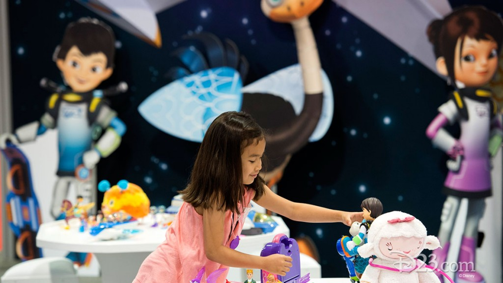Little girl playing with Disney toys at D23 EXPO 2015